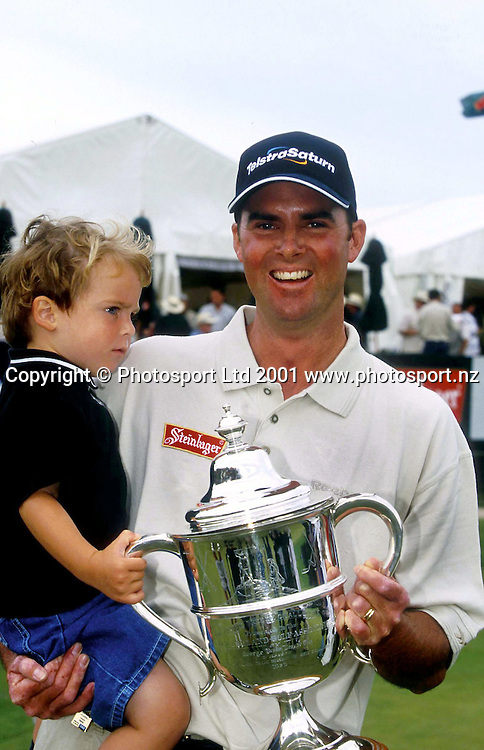 Telstra Saturn New Zealand Open winner, David Smail with his son Charles, holds the trophy after his victory at The Grange, Papatoetoe. (21/01/01)<br />Pic: Dean Treml/ PHOTOSPORT