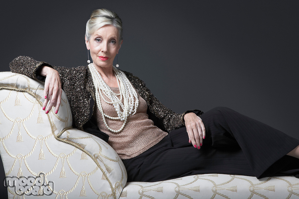 Wealthy Senior Woman on Chaise Lounge