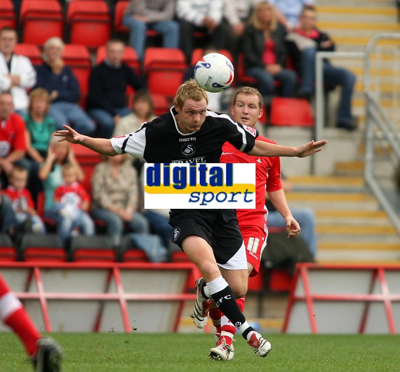 Photo: Chris Ratcliffe.<br />Leyton Orient v Swansea City. Coca Cola League 1. 26/08/2006.<br />Shaun MacDonald of Orient clashes with Joe Keith of Swansea (R).