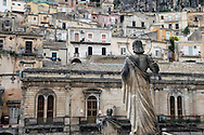 Statue of a a Saint watching over Modica, Italy