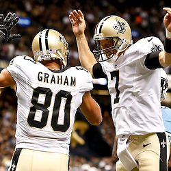 Aug 15, 2014; New Orleans, LA, USA; New Orleans Saints quarterback Luke McCown (7) and tight end Jimmy Graham (80) celebrate after a touchdown during second quarter of a preseason game against the Tennessee Titans at Mercedes-Benz Superdome. Mandatory Credit: Derick E. Hingle-USA TODAY Sports
