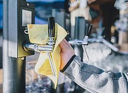 15.03.2020, Kaprun, AUT, Coronavirus in Österreich, im Bild ein Mitarbeiter reinigt den Zapfhahn eines Restaurants kurz vor der Schliessung // an employee cleans the tap of a restaurant shortly before closing. The Austrian government is pursuing aggressive measures in an effort to slow the ongoing spread of the coronavirus, Kaprun, Austria on 2020/03/15. EXPA Pictures © 2020, PhotoCredit: EXPA/ JFK