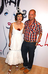 Fashion designer ALEXANDER MCQUEEN and ISABELLA BLOW at the launch of 'Blow Lips' a new lipstick by Isabella Blow and MAC Makeup held at the the Blow de la Barra Gallery, 35 Heddon Street, London on 7th September 2005.<br />
