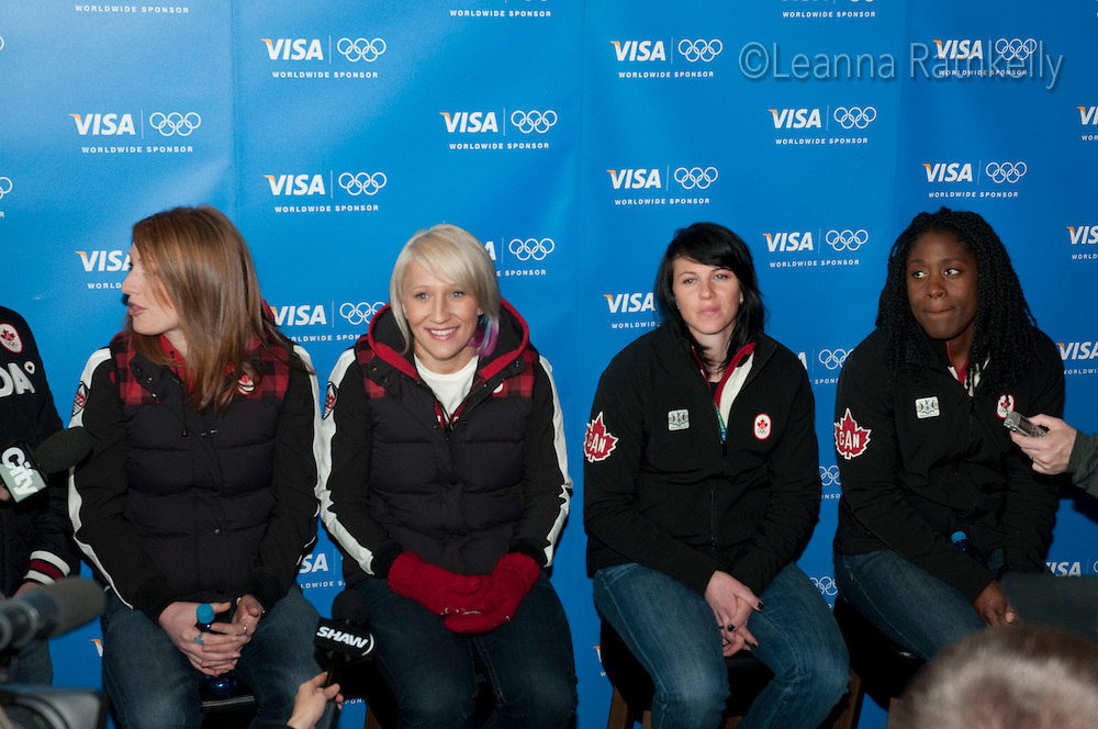 Gold medalists Heather Moyse, Kaillie Humphries, and silver medalists Helen Upperton and Shelley-Ann Brown talk to the press after winning the women's bobsleigh during the 2010 Olympic Winter Games in Whistler, BC, Canada.
