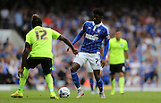 Ipswich Town midfielder Ainsley Maitland-Niles takes on Brighton defender, full back, Gaetan Bong during the Sky Bet Championship match between Ipswich Town and Brighton and Hove Albion at Portman Road, Ipswich, England on 29 August 2015.