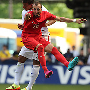 Ahmet Ilhan Ozek, Turkey, wins a header while challenged by Timmy Chandler, USA, during the US Men's National Team Vs Turkey friendly match at Red Bull Arena.  The game was part of the USA teams three-game send-off series in preparation for the 2014 FIFA World Cup in Brazil. Red Bull Arena, Harrison, New Jersey. USA. 1st June 2014. Photo Tim Clayton