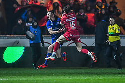 Scarlets' Tom Williams and Leinster's Rory O'Loughlin compete for the high ball<br /> <br /> Photographer Craig Thomas/Replay Images<br /> <br /> Guinness PRO14 Round 17 - Scarlets v Leinster - Friday 9th March 2018 - Parc Y Scarlets - Llanelli<br /> <br /> World Copyright © Replay Images . All rights reserved. info@replayimages.co.uk - http://replayimages.co.uk