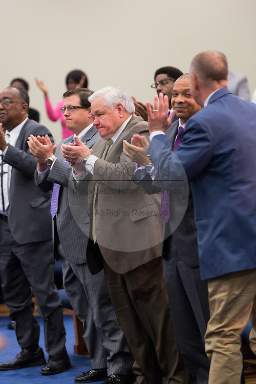 North Charleston Mayor Keith Summey (center) is given a standing ovation after Rev. Al Sharpton thanked him for doing the right thing during a healing service at Charity Missionary Baptist Church April 12, 2015 in North Charleston, South Carolina. Sharpton spoke following the recent fatal shooting of unarmed motorist Walter Scott police and thanked the Mayor and Police Chief for standing for justice in charging the officer with murder.