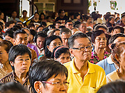 18 SEPTEMBER 2016 - BANGKOK, THAILAND:  Parishioners pray during the 100th anniversary mass for the sanctuary at Santa Cruz Catholic Church. Santa Cruz Church was establised in 1769 to serve Portuguese soldiers in the employ of King Taksin, who reestablished the Siamese (Thai) empire after the Burmese sacked the ancient Siamese capital of Ayutthaya. The church was one of the first Catholic churches in Bangkok and is one of the most historic Catholic churches in Thailand. The first sanctuary was a simple wood and thatch structure and burned down in the 1800s. The church is in its third sanctuary and was designed in a Renaissance / Neo-Classical style. It was consecrated in September, 1916. The church, located on the Chao Phraya River, serves as a landmark for central Bangkok.      PHOTO BY JACK KURTZ