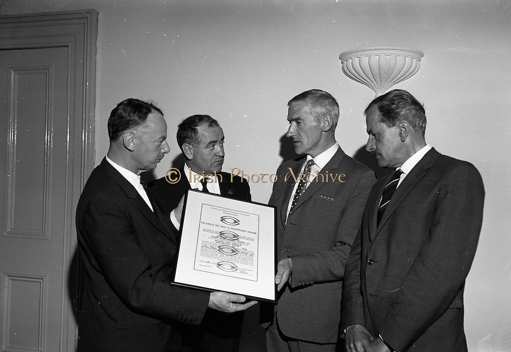 16/08/1967<br /> 08/16/1967<br /> 16 August 1967<br /> Presentation of new Fishery Standards Licence at the Shelbourne Hotel, Dublin. Image shows Dr. Arthur Hughes, Chairman of the Institute for Industrial Research and Standards (left) presenting Mr. P.J.Hardy, Managing Director of Seaborn Ltd., Dublin, with the first licence issued under the new fishery standards prepared by the Institute. Centre is the Chairman of Bord Iascaigh Mhara/Irish Sea Fisheries Board, Mr. Brendan O'Kelly and on the right is Mr. Alan H. Porter, The Director of the Standards Division of the Institute.