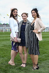 © Licensed to London News Pictures. 08/04/2016. Liverpool, UK. Three glamorous women pose for a picture on Ladies Day at the Grand National 2016 at Aintree Racecourse near Liverpool. The race, which was first run in 1839, is the most valuable jump race in Europe. Photo credit : Ian Hinchliffe/LNP