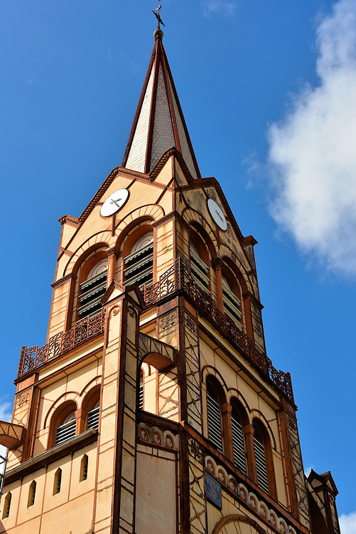 Saint Louis Cathedral&rsquo;s Steeple in Fort-de-France, Martinique <br /> Since 1657, six Catholic churches have existed on this site in downtown Fort-de-France but all were destroyed, usually by a natural disaster.  The St. Louis Cathedral was built in 1895, restored in 1978 and was being refurbished in 2015. It is nicknamed the &ldquo;Iron Cathedral&rdquo; because of its iron beams designed to survive hurricanes and earthquakes. This steeple rises 187 feet.