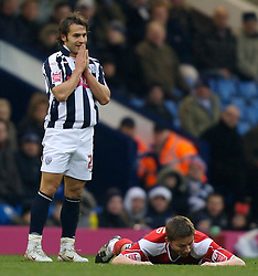 WEST BROMWICH, ENGLAND - Saturday, December 15, 2007: West Bromwich Albion's Filipe Teixeira prays for forgiveness after fouling Charlton Athletic's Matthew Holland during the League Championship match at the Hawthorns. (Photo by David Rawcliffe/Propaganda)