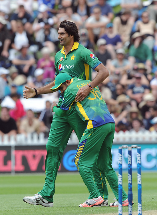Pakistan's Mohammad Irfan is hugged by Babar Azam after dismissing New Zealand's Martin Guptill for 11 in the 1st ODI International Cricket match at Basin Reserve, Wellington, New Zealand, Monday, January 25, 2016. Credit:SNPA / Ross Setford