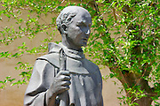 Father Serra statue in the courtyard at Mission San Miguel Archangel (16th Mission-founded 1797), Jolon, California