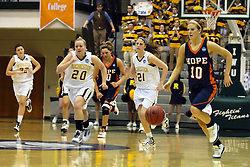 19 March 2010: Jenny Cowen takes off on a break-a-way. The Flying Dutch of Hope College defeat the Yellowjackets of the University of Rochester in the semi-final round of the Division 3 Women's Basketball Championship by a score of 86-75 at the Shirk Center at Illinois Wesleyan in Bloomington Illinois.