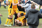 Mickey Demetriou celebrates at the final whistle during the EFL Sky Bet League 2 match between Newport County and Notts County at Rodney Parade, Newport, Wales on 6 May 2017. Photo by Daniel Youngs.