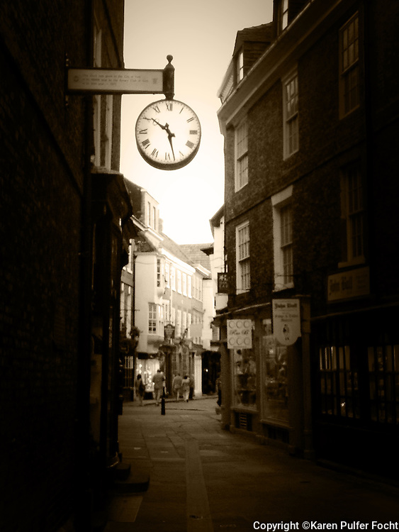 The streets of York, England. A tourist destination with boutiques, street musician and quaint eateries. It is a mid-evil walled in city.