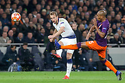 Harry Kane forward of Tottenham Hotspur shoots at goal with Manchester City midfielder Fernandinho Luiz Roza (25) blocking during the Champions League Quarter-Final 1st leg between Tottenham Hotspur and Manchester City at Tottenham Hotspur Stadium, London, United Kingdom on 9 April 2019.
