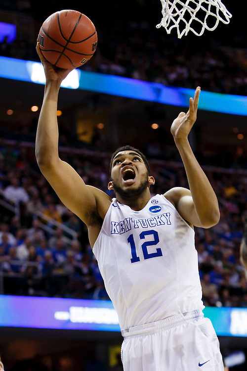 Mar 28, 2015; Cleveland, OH, USA; Kentucky Wildcats forward Karl-Anthony Towns (12) shoots against the Notre Dame Fighting Irish in the finals of the midwest regional of the 2015 NCAA Tournament at Quicken Loans Arena. Mandatory Credit: Rick Osentoski-USA TODAY Sports