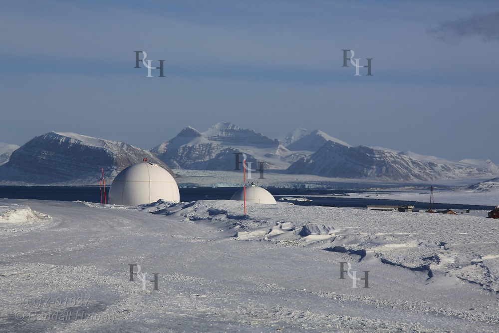 Antenna domes sits at Hamarabben Airport above the international science village of Ny-Alesund on Spitsbergen island in Kongsfjorden; Svalbard, Norway.