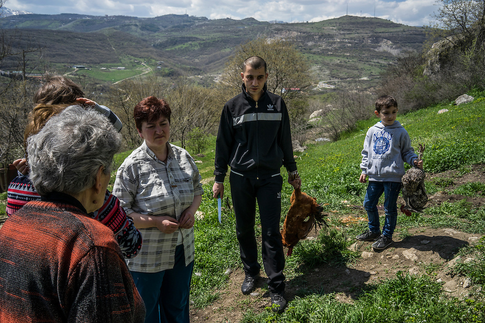 KARASHEN, NAGORNO-KARABAKH - APRIL 19: Members of the Abrahamyan family gather at a sacred site to sacrifice a chicken in order to bring good fortune on April 19, 2015 in Karashen, Nagorno-Karabakh. Since signing a ceasefire in a war with Azerbaijan in 1994, Nagorno-Karabakh, officially part of Azerbaijan, has functioned as a self-declared independent republic and de facto part of Armenia, with hostilities along the line of contact between Nagorno-Karabakh and Azerbaijan occasionally flaring up and causing casualties. (Photo by Brendan Hoffman/Getty Images) *** Local Caption ***