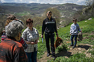 Members of the Abrahamyan family gather at a sacred site to sacrifice a chicken in order to bring good fortune on April 19, 2015 in Karashen, Nagorno-Karabakh. Since signing a ceasefire in a war with Azerbaijan in 1994, Nagorno-Karabakh, officially part of Azerbaijan, has functioned as a self-declared independent republic and de facto part of Armenia, with hostilities along the line of contact between Nagorno-Karabakh and Azerbaijan occasionally flaring up and causing casualties.
