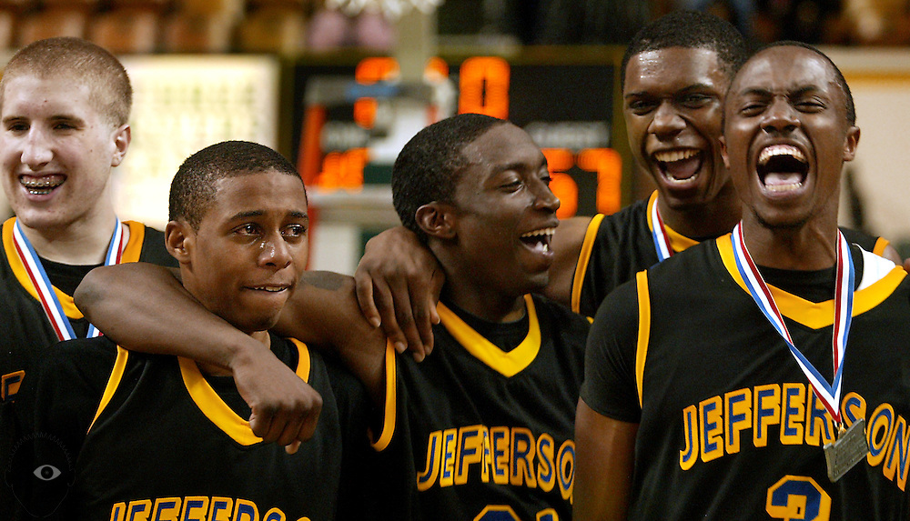 03/13/2010 - Jefferson teammates are full of joy as they receive their firts-place medals following their victory. Jefferson beat Mountain View 57-48 in the 2010 OSAA 5A Basketball State Championship game from Mac Court on the University of Oregon.