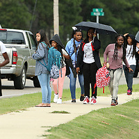 Adam Robison | BUY AT PHOTOS.DJOURNAL.COM<br /> Students from Tupelo Middle School use the sidewalk on Ida Steet as they walk home after school Friday afternoon.