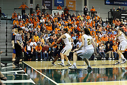 19 March 2010:Philana Greene tries the baseline against  Michelle Ketcham and Melissa Alwardt. The Flying Dutch of Hope College defeat the Yellowjackets of the University of Rochester in the semi-final round of the Division 3 Women's Basketball Championship by a score of 86-75 at the Shirk Center at Illinois Wesleyan in Bloomington Illinois.
