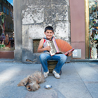 Boy playing an accordion in Old Town, Krakow, Poland.