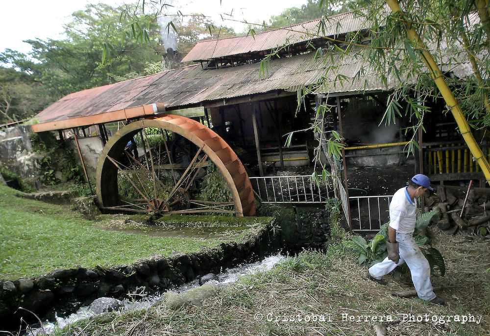 "Alvaro Murillo walks around the watermill powered-sugarcane process plant ""Los Trapiches""  on Saturday, January 6th, 2007. in Tacares,  about 25 miles West from San Jose, Costa Rica. Los Trapiches was founded 101 years ago and still produces handcrafted toffee, melaza, and other sugarcane by-products, daily consumed by Costa Ricans. (Photo/Cristobal Herrera)"