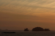 Small island are silhouetted in the sunset light near Prince Rupert in Northern British Columbia