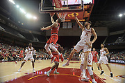 Western Kentucky Hilltoppers forward Justin Johnson (23) shoots the ball as Southern California Trojans forward Nick Rakocevic (31) defends during an NCAA college basketball game in the second round of the NIT tournament in Los Angeles, Monday, Mar 19, 2018. WKU defeated USC 79-75.