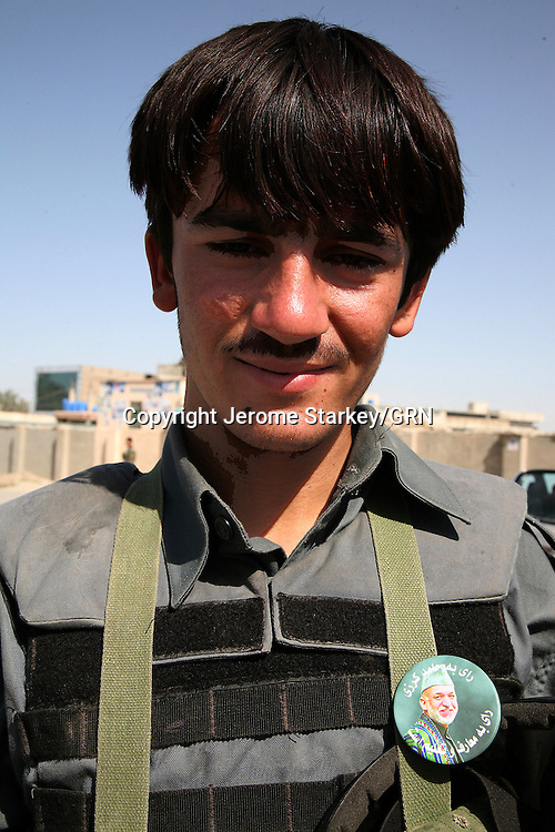 """Policeman Mohammed Noor, 18, from Nawa, said: """"Karzai is going to win. Everyone loves him."""""""