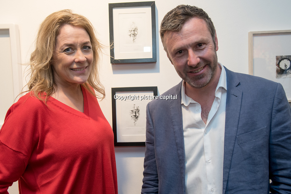 Sarah Beeny is an TV Presenter and her husband is an artist Graham Swift attend the Art On The Mind - Private view of an exhibition and auction which benefits homeless charity, Cardboard Citizens.