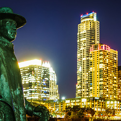 Panorama photo of Stevie Ray Vaughan Memorial bronze statue with the Austin, Texas skyine at night. Austin, TX is a major city in the Southwestern United States of America.