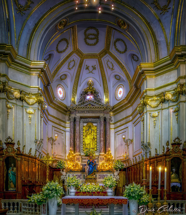 """""""High Privileged Altar - Church of Our Lady of the Assumption Positano""""...<br /> <br /> The history of the Church of Our Lady of the Assumption is closely linked to the Benedictine monastery of St. Mary, which, according to tradition, was built when a Byzantine icon of the Virgin was brought to Positano and venerated thereafter. The Icon belonged to a cargo ship from the East, and offshore of Positano the ship was stopped by a dead calm sea. After unsuccessful attempts to continue sailing, the sailors heard a voice saying """"Posa Posa"""", meaning, """"Put me down, put me down!"""" (Origin of the name """"Positano""""). The captain thought this miracle meant that the Virgin wanted to stop there and decided to head for shore. At that point…the ship began to sail again. The sailors disembarked the icon and gave it to the inhabitants of Positano, who chose the Virgin as their patron and built a church in her honor. The Church of Santa Maria Assunta is a prominent aspect of Positano's cultural, religious and architectural landscape. Strategically located in the center of town with the backdrop of the azzurro Mediterranean Sea, the church's colorful majolica tiled cupola is one of the town's iconic symbols. I found this Crucifix inside a small chapel of the ancient church which was dedicated to the Blessed Virgin Mary in 1159. Santa Maria keeps a blessed and watchful eye over Positano and welcomes all to this beautiful seaside village."""