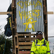 Anti-fracking  activists and protesters outside the gates of Quadrilla's fracking site June 31st, Lancashire, United Kingdom. The struggle against fracking in Lancashire has been going on for years. The fracking company Quadrilla is finally ready to bring in a drill tower to start drilling and anti-frackinhg activists are waiting in front of the gates to block the equipment getting in. Fracking is a destructive and potential dangerous and highly contentious method of extracting gas and this site will be the first of many in the United Kingdom reaching miles out under ground.