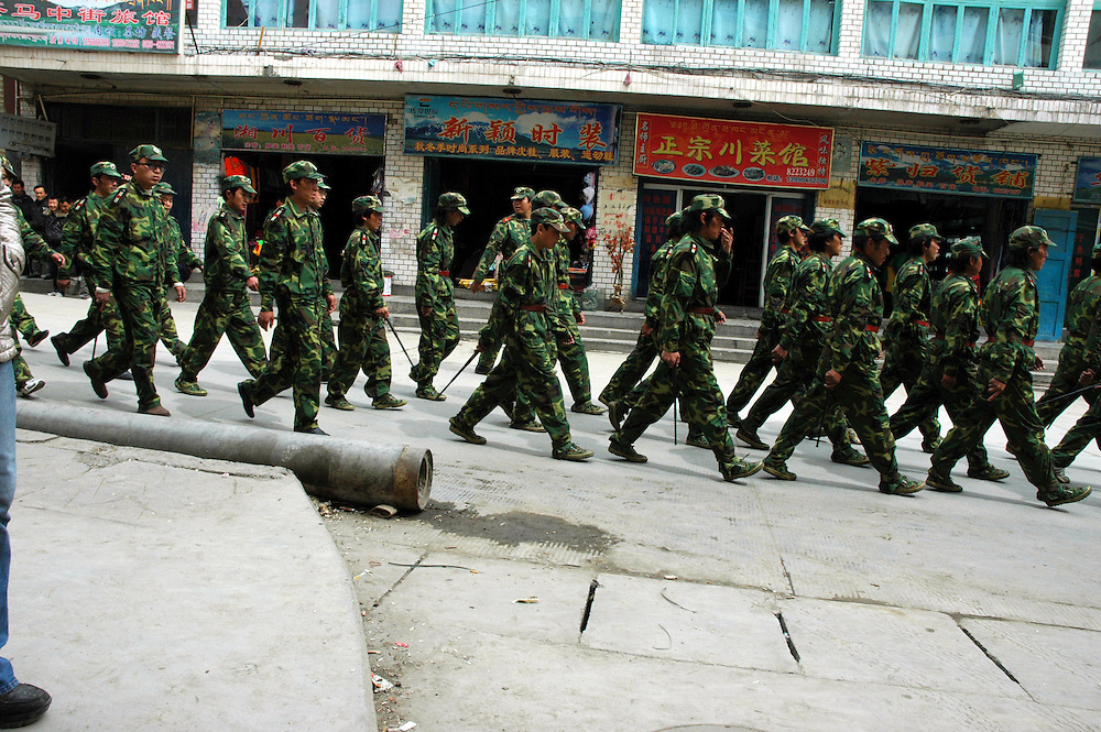 Chinese soldiers on the streets of Dege - taken March 20, 2008 - Michael Benanav - 505-579-4046..