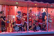Pine Bush, New York - Dancers pose in the window of the Mitchell Performing Arts Center during the Community Country Christmas presented by the Pine Bush Chamber of Commerce on Dec. 1, 2012.