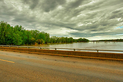 30 Apr 2019: Muddy water rolls as the Kickapoo Creek overflows its banks and into the flood plane north of Waynesville in Dewitt County Illinois