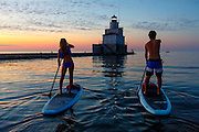 Sunrise stand up paddle boarding near the Manitowoc Lighthouse on Lake Michigan Manitowoc, Wisconsin.  Photo by Mike Roemer