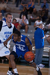 25 June 2011: Chasson Randle pushes into Mike Turner (northwestern recruit) at the 2011 IBCA (Illinois Basketball Coaches Association) boys all star games.