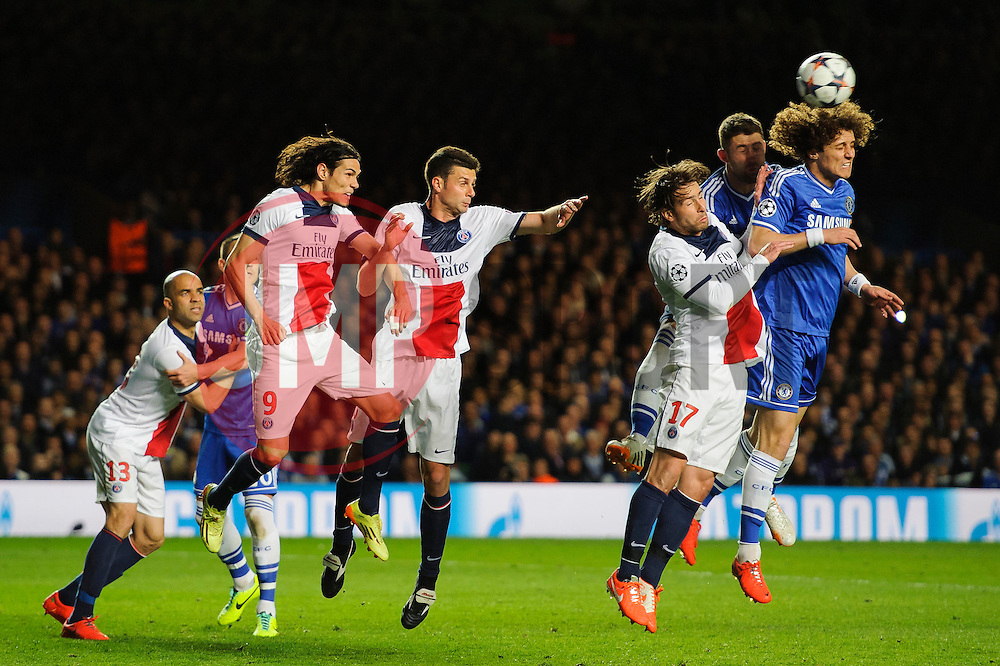 Chelsea Defender David Luiz (BRA) and PSG Defender Maxwell (BRA) compete in the air from a free kick - Photo mandatory by-line: Rogan Thomson/JMP - 07966 386802 - 08/04/2014 - SPORT - FOOTBALL - Stamford Bridge, London - Chelsea v Paris Saint-Germain - UEFA Champions League Quarter-Final Second Leg.