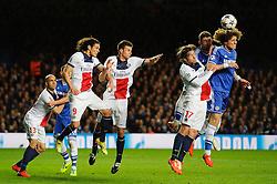 Chelsea Defender David Luiz (BRA) and PSG Defender Maxwell (BRA) compete in the air from a free kick - Photo mandatory by-line: Rogan Thomson/JMP - 07966 386802 - 08/04/2014 - SPORT - FOOTBALL - Stamford Bridge, London - Chelsea v Paris Saint-Germain - UEFA Champions League Quarter-Final Second Leg.