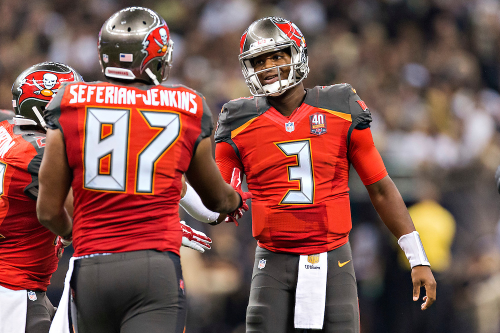 NEW ORLEANS, LA - SEPTEMBER 20:  Jameis Winston #3 talks with Austin Seferian-Jenkins #87 of the Tampa Bay Buccaneers during a game against the New Orleans Saints at Mercedes-Benz Superdome on September 20, 2015 in New Orleans Louisiana.  The Buccaneers defeated the Saints 26-19.  (Photo by Wesley Hitt/Getty Images) *** Local Caption *** Jameis Winston; Austin Seferian-Jenkins