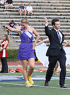 Samford homecoming attendants Leah Clements and Tim Foote dance across the field as their names are called during halftime of the game at Seibert Stadium in Homewood, Ala., Saturday, Oct 13, 2012. (Marvin Gentry)
