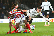 Derby County midfielder Harry Wilson (7) goes down after a strong challenge from Stoke City defender Bruno Martins Indi (15) during the EFL Sky Bet Championship match between Derby County and Stoke City at the Pride Park, Derby, England on 13 March 2019.