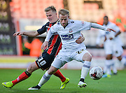 Barry Bannan and Matt Ritchie during the Sky Bet Championship match between Bournemouth and Bolton Wanderers at the Goldsands Stadium, Bournemouth, England on 27 April 2015. Photo by Adam Rivers.